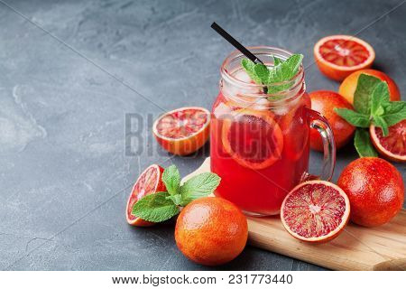 Summer Cold Lemonade Drink Or Juice Decorated Mint Leaves In Mason Glass Jar On Black Stone Table.
