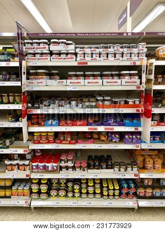 LONDON - MARCH 14, 2018: Jars of spreadable products on sale at Sainsbury's supermarket at The O2 Centre, Finchley Road, North London, UK.