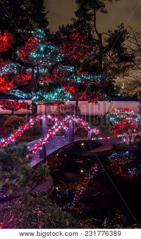 Panoramic Picture Of Christmas Lights All Around The Bridge, Trees, Signs, Posts Houses And Lights A