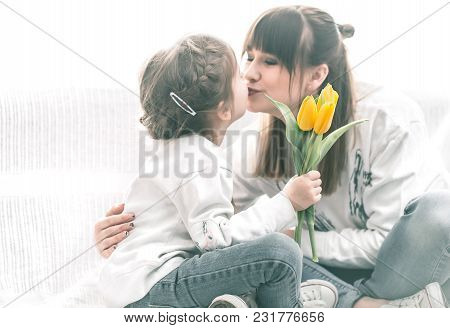 Daughter Mom Gives Flowers