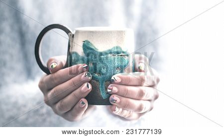 Girl With A Cup In Hands
