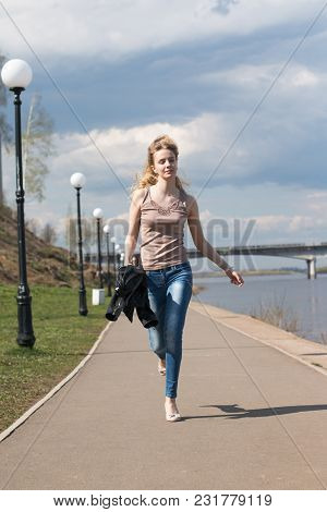 Girl With Blond Hair On The Promenade