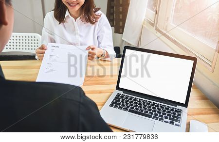 Young Woman Submit Resume To Employer To Review Job Application. The Concept Presents The Ability Fo