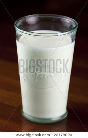 Milk in cow glass