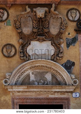 VERONA, ITALY - MAY 27: Bass relief on the wall of Palazzo Ragione in Piazza dei Signori in Verona, Italy, on May 27, 2017.