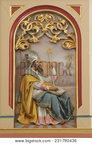 SISAK, CROATIA - DECEMBER 07: Saint Ambrose, Great Doctor of the Western Church, pulpit in the Church of Holy Cross in Sisak, Croatia, on December 07, 2017.