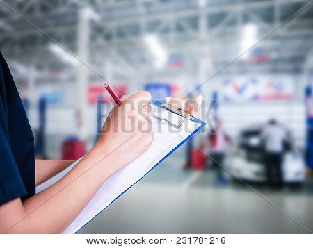 Asian Women Engineers And Technicians Are Checking Mechanic And Inspecting On A Car In Auto Repair S