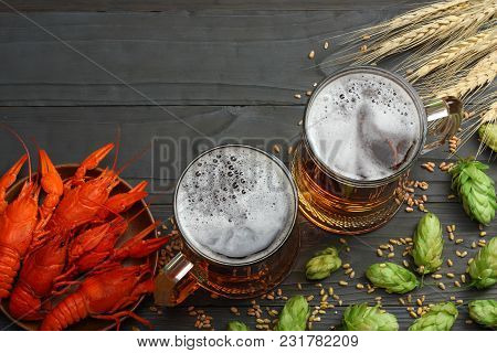 Glass Beer With Crawfish, Hop Cones And Wheat Ears On Dark Wooden Background. Beer Brewery Concept.