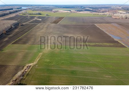 Aerial Fields In Early Spring. Aerial Shot Of Fields With Various Types Of Agriculture Early Spring