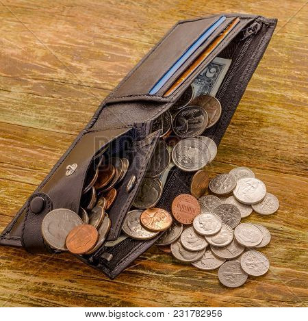 Old Banknote Of Two Us Dollars And  Scratched Cents Us Lies In A Black Worn Wallet. The Concept Of P