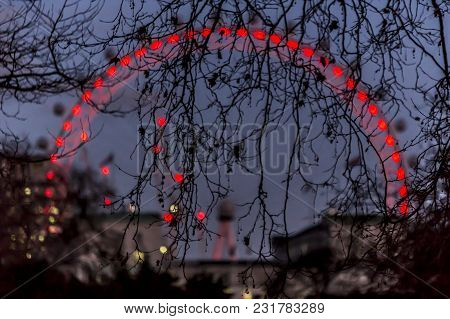 The London Eye Is A Giant Ferris Wheel On The South Bank Of The River Thames In London.  The Structu