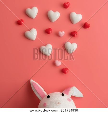 A Handmade Rabbit Look At The Floating Heart With A Pink Background.happy Valentines Day Background.