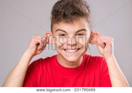 Silly Boy Making Grimace - Funny Monkey Face. Child With Big Ears, Isolated On White Background. Emo
