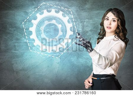 Young Business Woman With Robot Hand Point On Digital Cogwheels. Hand Prosthesis Concept.