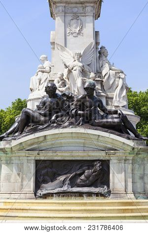 London, United Kingdom - June 21, 2017: Bronze Statues Around The Queen Victoria Memorial In Front O