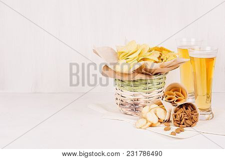 Summer Snacks And Lager Beer In Glass  - Nachos, Croutons, Chips, Tortilla In Rustic Basket And Pape