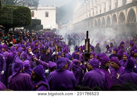 Antigua, Guatemala: March 18 2018: Hunderds Of Purple Robed Men And Incense Smoke At The Procession