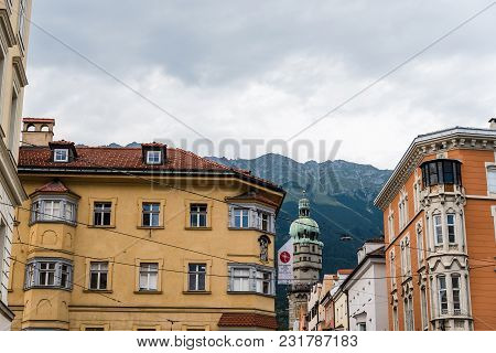 Innsbruck, Austria - August 9, 2017: Low Angle View Of Stadtturm Or City Tower And Old Buildings Aga