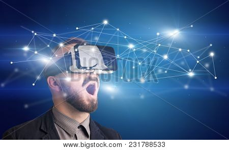Amazed businessman with virtual reality network concept in front of him
