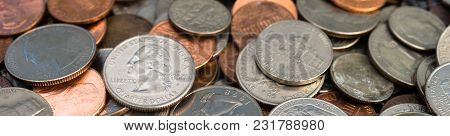 A Pile Of Coins Is Cropped Into A Long Horizontal Panoramic Composition