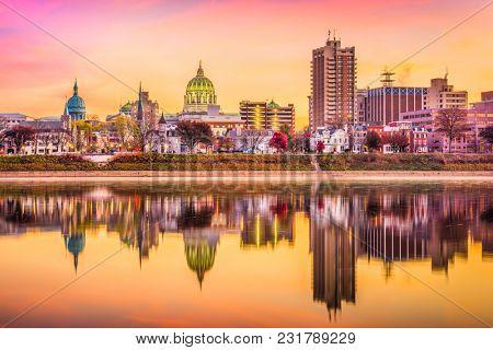 Harrisburg, Pennsylvania, USA downtown skyline on the Susquehanna River at dusk.