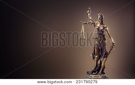 Statute Of Justice. Bronze Statue Lady Justice Holding Scales And Sword