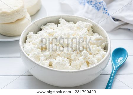 Tvorog, Farmers Cheese, Curd Cheese Or Cottage Cheese In White Bowl On White Wooden Table, Closeup V