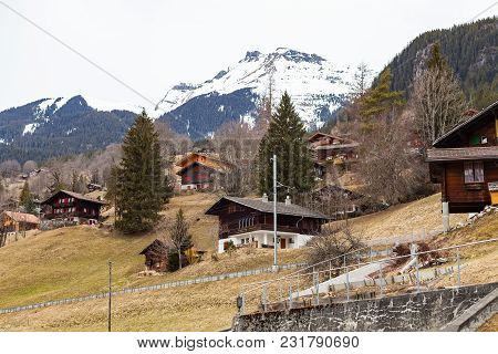 Scenic Picture Of The Swiss Alps, Grindelwald Touristic Village In Switzerland, Bernese Region