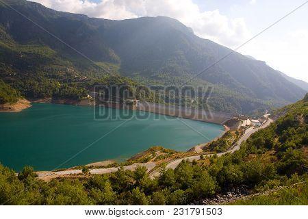 Dam On The Reservoir In Turkey. Hydraulic Construction.
