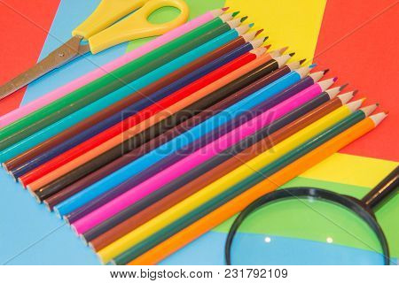 Bright Colored Wooden Pencils On A Colored Background. The Sharp Tips Of The Pencils. The Concept Of