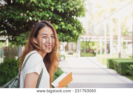 Young Traveler Asian Woman Admiring Beautiful Sunny Narrow Streets In Bangkok, Thailand. Sunny Day I