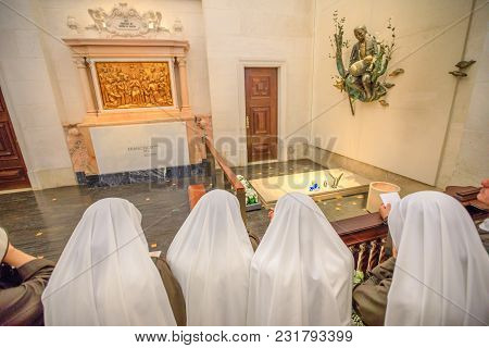 Fatima, Portugal - August 15, 2017: Nuns Pray Before One Of Graves Of Shepherds Who Saw The Appariti