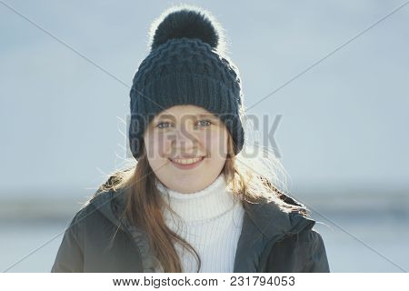 Portrait Sunlit Teenage Girl Wearing Winter Clothes In Winter Outside, Youth Pastime And Rest