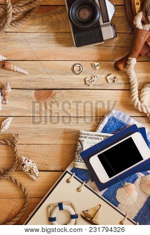 Striped Towel, Camera, Phone And Maritime Decorations, Top View