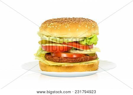 Tasty Hamburger, Beef Burger In Close-up On A Plate And Isolated On White Background.
