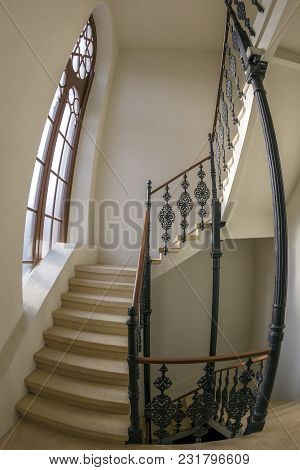 Interior Staircase In A Synagogue Decorated With Specific Patterns And Railings Made Of Wrought Iron