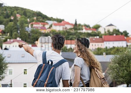 Two Beautiful Young Tourists With Camera In The Old Town.