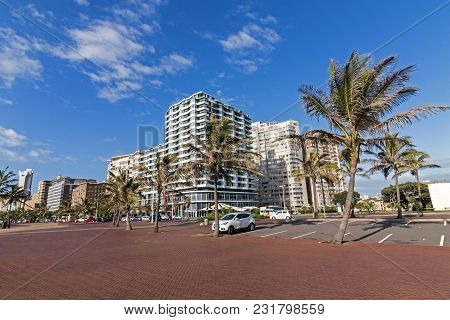 Empty Paved Promenade Against City Beachfront Skyline