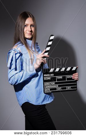 Young Beautiful Woman With Movie Cracker