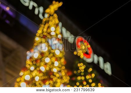 Defocused And Bokeh Bright And Glow Glitter Christmas Tree At Night