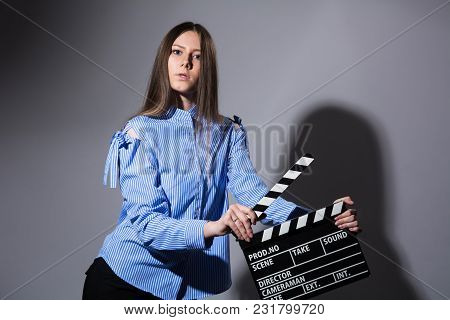 Young Beautiful Brown-haired Woman With A Movie Cracker