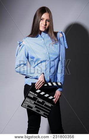 Young Brown-haired Woman With A Movie Cracker