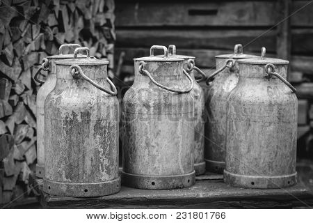 Many Old Milk Canisters At A Farm