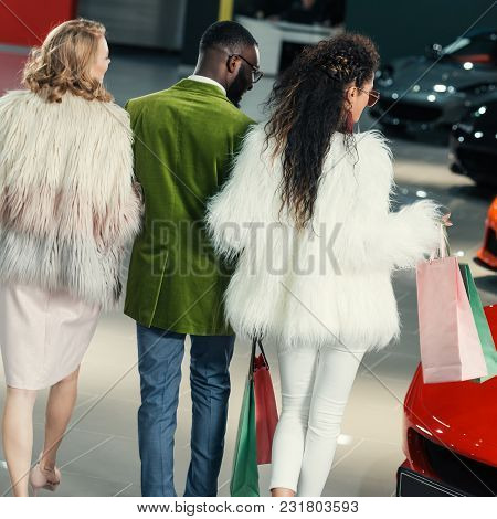 Stylish Young Shoppers Walking By Auto Showroom