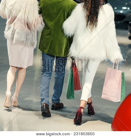Cropped Shot Of Young Shoppers Walking By Auto Showroom