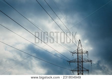 Wires Pole With Blue Sky. Electrical Wires On A Background. Electric Cables. Power Cable With Blue S