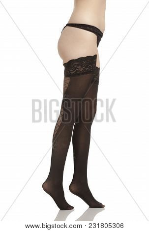Female Legs With Bikini And Pantyhose On White Background Vertical Image.