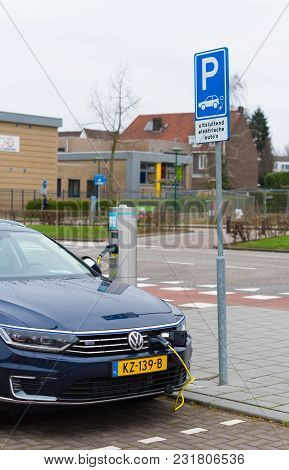 Roermond, Netherlands - March 19, 2017: Volkswagen Passat E-car Being Charged On The Street