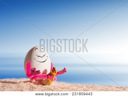 Funny Easter Egg Girl Doing Yoga And Meditating On A Sea Beach. Healthy Concept.
