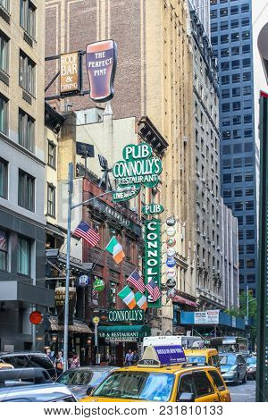 NEW YORK CITY-JULY 16: New York City architecture and Pub Connollys near Time Square in New York, USA on July 16, 2014.